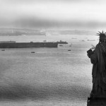 Statue of Liberty seen with the U.S.S. Lafayette, 1945. Amid increasing European hostilities, France's Normandie sought refuge in New York at Pier 88. In 1941, the Navy assumed the ship, and changed its name to the U.S.S. Lafayette. On the 9th of February, 1942, a fire broke out and the ship capsized. Although salvaged at great expense, restoration was deemed too costly and she was scrapped in October 1946.